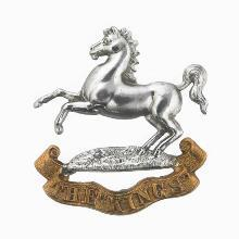Image of the King's (Liverpool) Regiment cap badge © IWM (INS 5535), reproduced under the IWM Non-Commercial Licence.